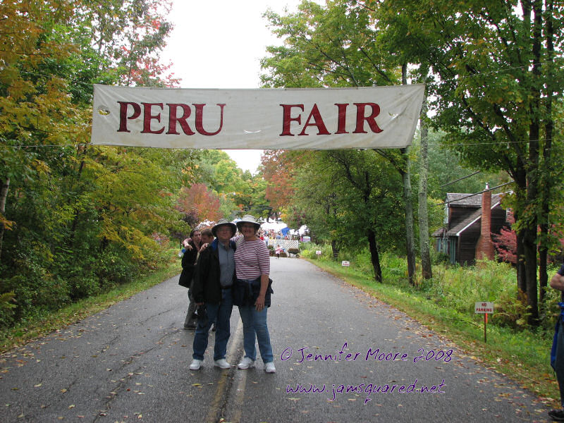John and Mary Ann under the Peru Fair Banner