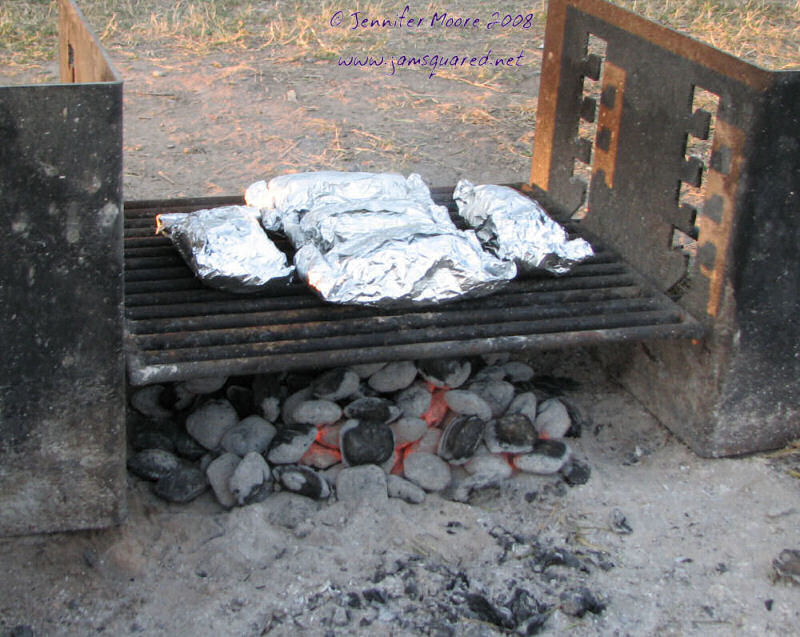 Dinner Cooking Over the Campfire